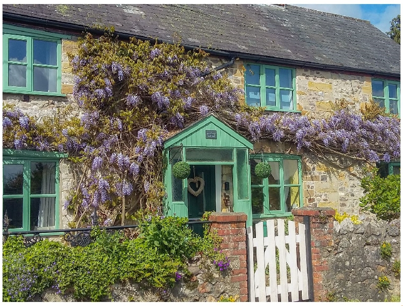 Click here for more about 2 Wisteria Cottages